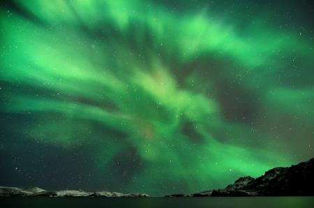 Flash of Aurora polaris above water