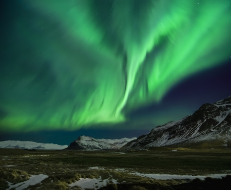northern lights: Flash of Aurora polaris above mountains