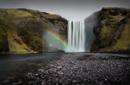 Skogafoss waterfall with rainbow , Iceland