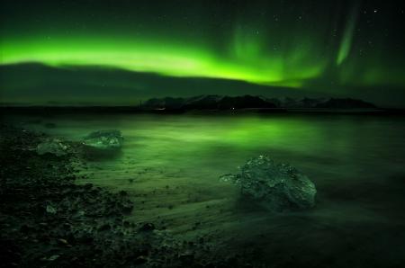 northern light: Flash of Aurora polaris above water