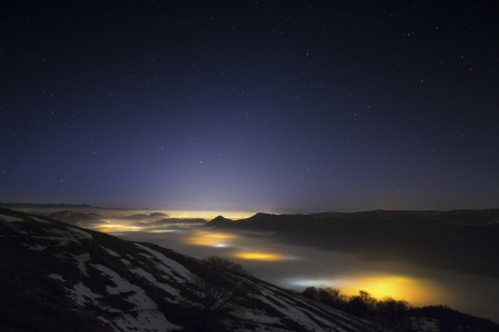 Stars in a foggy night over the valley, near Pamplona, Spain
