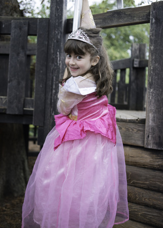 princess dress: Little girl playing in the playground on her princess costume