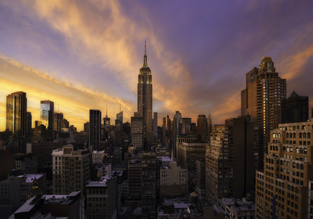 Colorful sunset over manhattan skyline, New york