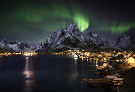 Northern lights over Reine, Lofoten islands, Norway, polar circle