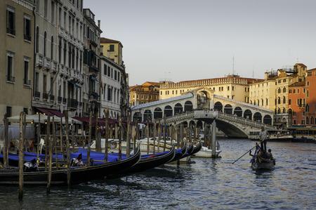 VENICE, ITALY - September 2011: Typical canal scene of gondolas and gondoliers, in Venice, Veneto, Italy