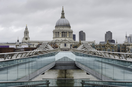 saint pauls cathedral: Saint Paul`s cathedral from millennium bridge, London, in a cloudy day