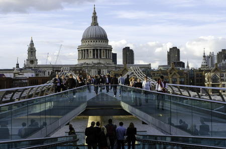 saint pauls cathedral: London, UK, September October 2012: Lot of people walking along the Millennium bridge with Saint Paul`s cathedral on the background on september October 2012 Editorial