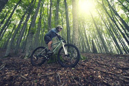 competitive: Rider in action at Freestyle Mountain Bike Session Stock Photo