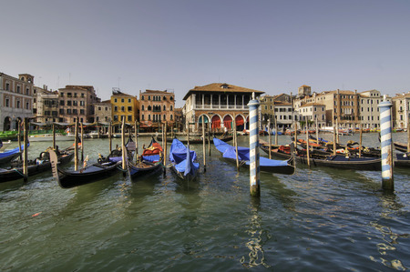 gondoliers: VENICE, ITALY - September 2011: Typical canal scene of gondolas and gondoliers, in Venice, Veneto, Italy