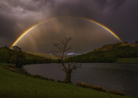 lake district england: Rainbow over the Lake, Cumbria, lake district, England Stock Photo