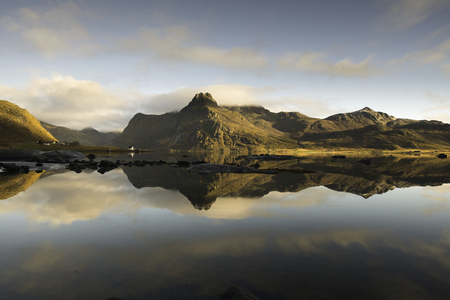 Reflections in the fjord, Lofoten islands, Norway in a sunny day Stock Photo