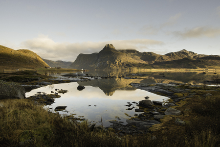Lake with wooden cabins in the shore, Lofoten islands, Norway in a sunny day