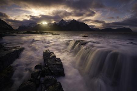 Waterfall on Vareid, Lofoten islands, Norway in winter