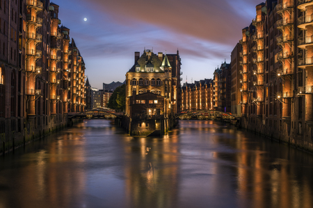 Full moon at sunset over the canals of Hamburg, Germany