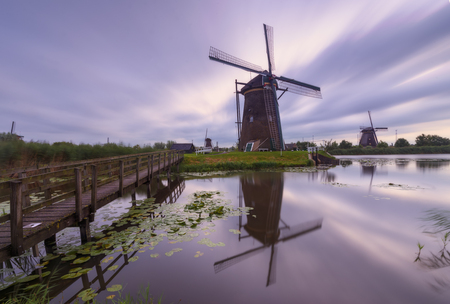 Windmills of Kinderdijk village, Holland, in a cloudy morning