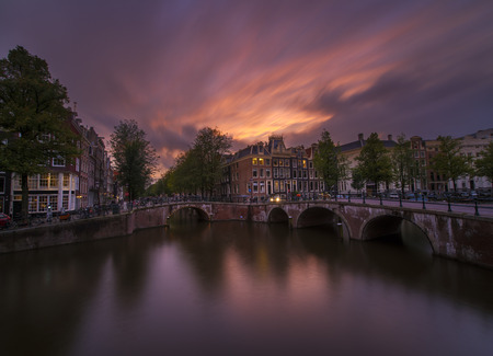 Colorful sunset over Amsterdam`s canals