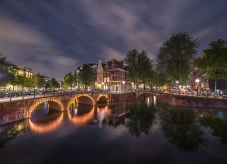Night lights over Amsterdam channels, Holland Stock Photo