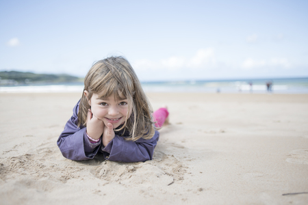Little girl at the beach in winter Stock Photo