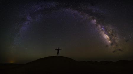 Milky Way arch over the desert of Chigaga, Morocco Stock Photo