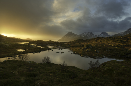 Colorful sunrise over a lake in Norway, Lofoten islands Stock Photo