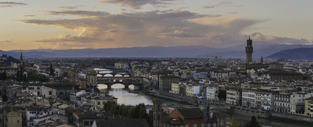 Colorful sunset over Florence, Arno river and bridges Stock Photo