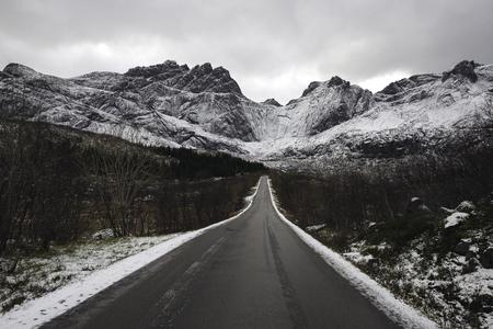 Lone mountain road in winter, Lofoten islands, Norway Stock Photo