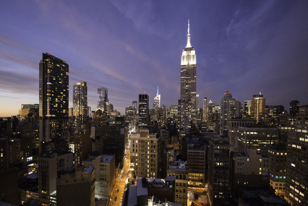 Manhattan skyline at night from a high rooftop