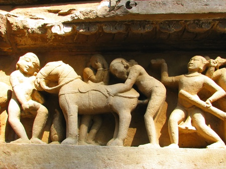 Stone carved erotic sculptures in Hindu temple in Khajuraho, Madhya Pradesh, India Stock Photo - 13037433