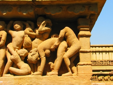 Stone carved erotic sculptures in Hindu temple in Khajuraho, Madhya Pradesh, India Stock Photo - 13037370