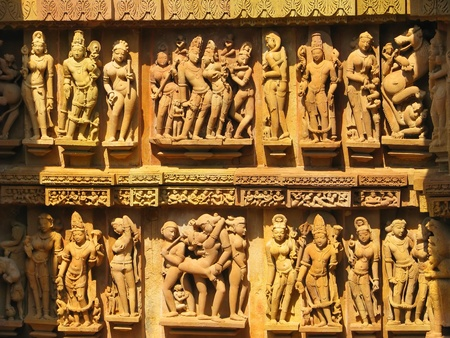 Stone carved erotic sculptures in Hindu temple in Khajuraho, Madhya Pradesh, India Stock Photo - 13037466