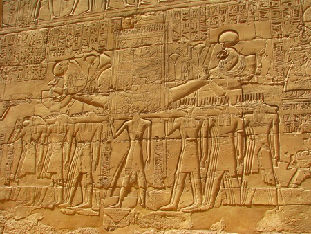 Ancient stone carved Egyptian hieroglyphics in Karnak temple, Luxor, Egypt photo