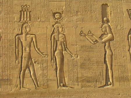 Ancient stone carved Egyptian hieroglyphics in Egypt photo