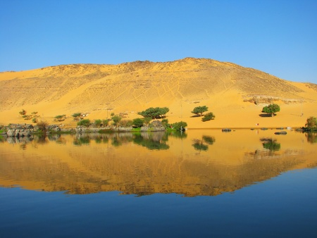 nile river: Reflection of a sand dune over the Nile river, Aswan, Egypt