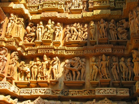 Stone carved erotic sculptures in Hindu temple in Khajuraho, Madhya Pradesh, India Stock Photo - 13060909