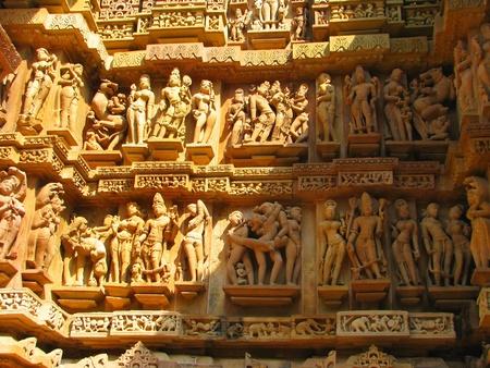 Stone carved erotic sculptures in Hindu temple in Khajuraho, Madhya Pradesh, India Stock Photo - 13060909