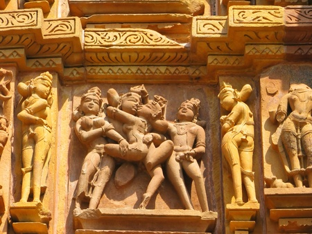 Stone carved erotic sculptures in Hindu temple in Khajuraho, Madhya Pradesh, India Stock Photo - 13060897