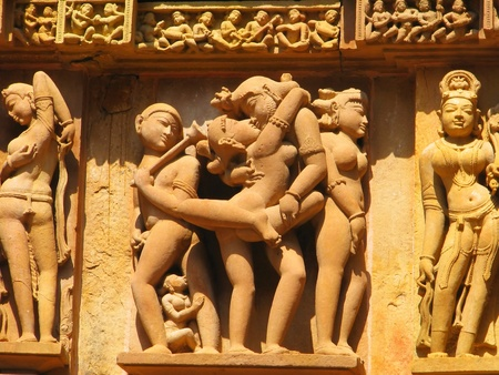 Stone carved erotic sculptures in Hindu temple in Khajuraho, Madhya Pradesh, India Stock Photo - 13060847