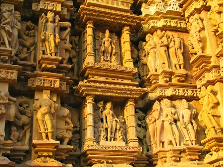 Stone carved erotic sculptures in Hindu temple in Khajuraho, Madhya Pradesh, India Stock Photo - 13060916
