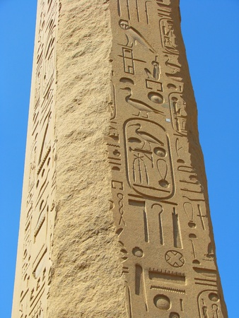 Obelisk with ancient stone carved Egyptian hieroglyphics in Karnak temple, Luxor, Egypt photo