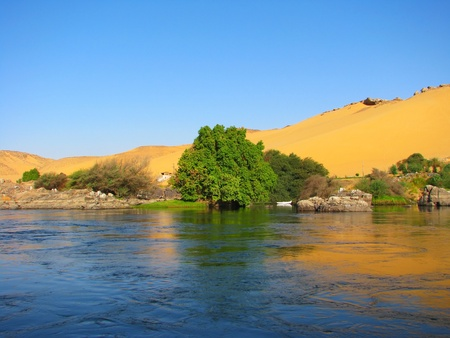 nile: Reflection of a sand dune over the Nile river, Aswan, Egypt