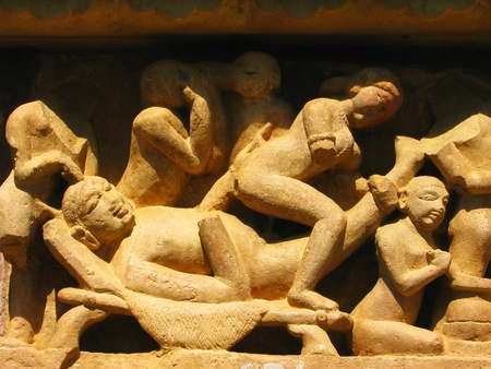 Stone carved erotic sculptures in Hindu temple in Khajuraho, Madhya Pradesh, India Stock Photo - 13085841