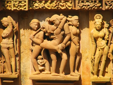 Stone carved erotic sculptures in Hindu temple in Khajuraho, Madhya Pradesh, India Stock Photo - 13085847