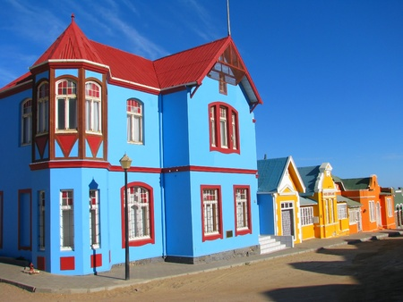 unique characteristics: Multicoloured houses in Nachtigal Strasse, Luderitz, Namibia