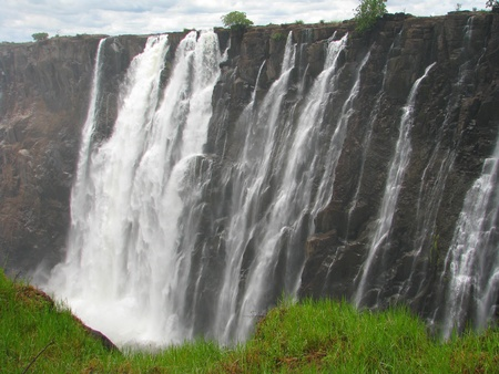 zambezi: Majestic Victoria Falls on Zambezi River, border of Zambia and Zimbabwe Stock Photo