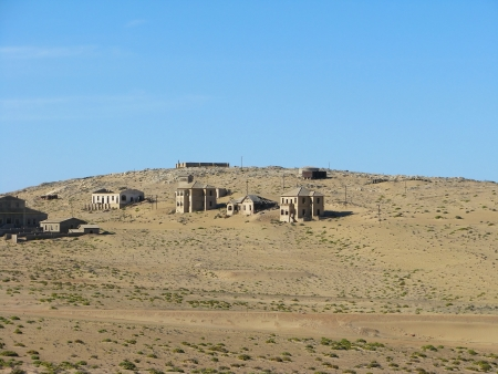 Ruins of houses in ghost town Kolmasnkop, Namibia photo
