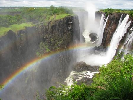 natural wonders: Rainbow over Victoria Falls on Zambezi River, border of Zambia and Zimbabwe