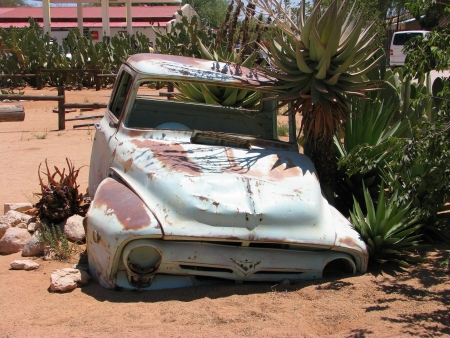 Old car wreck on Namibian desert, Solitaire, Namibia photo