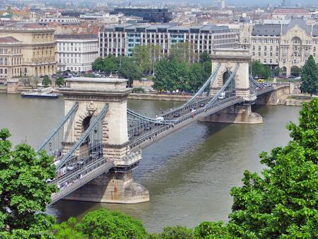 building a chain: Szechenyi Chain Bridge on Danube River, Budapest, Hungary
