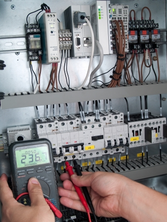 Engineer makes maintenance of power network automation photo
