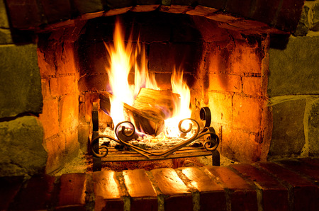 Home Fire burning in the fireplace. Seasonal and holiday fire 스톡 콘텐츠